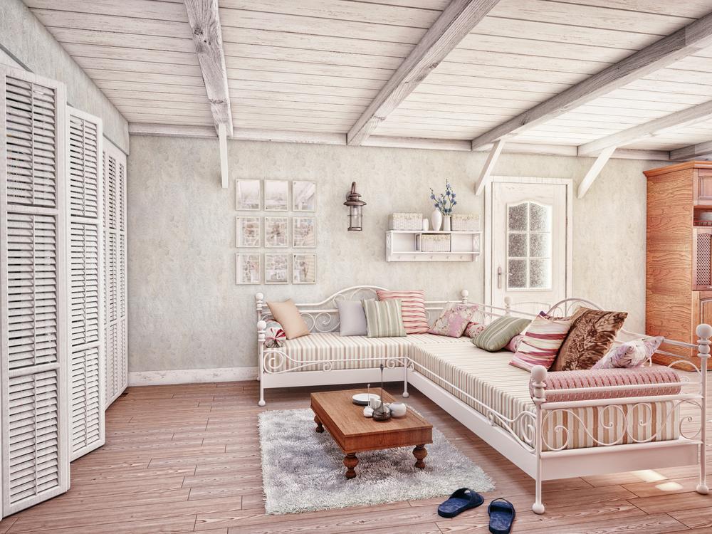 Ambiente con divano angolare in stile Shabby Chic
