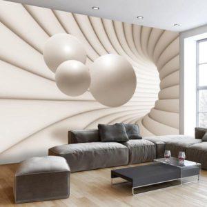 Salotto con grande disegno astratto in 3d a tutta parete ottenuto con una speciale carta da parati