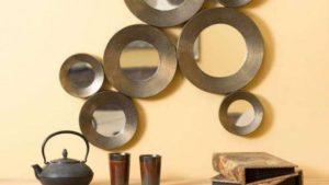 Composizione di specchi da arredo in Metallo e bronzo